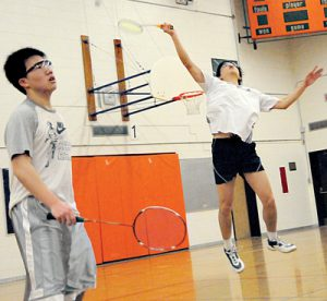 HAVING A BIRD: Boys Double A Leo Quin returns a York Mills shot while teammate Sam Choi looks on.