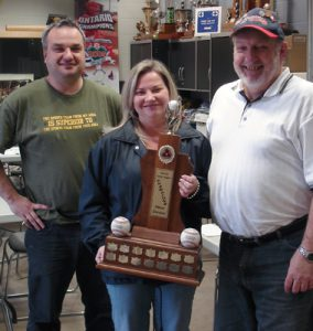 WE ARE THE CHAMPIONS: Elizabeth Alves holds the High Park's Little League championship trophy from last season while Ernest Hudaj and Ken Sherbanowksi bask in the victory.