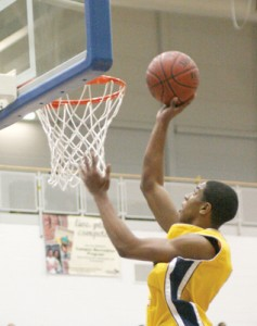 PHOTO COURTESY LINDSEY EVANOFF THE LAYUP: Kevin Blake drains an easy deuce in Oakwood's 47-34 win over St. Thomas More