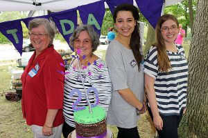 BRIAN BAKER/TOWN CRIER FOUNDING MOTHERS: Linden School co-founders Diane Goudie and Eleanor Moore team up with 2004 alum Ashleigh Zellermeyer and Emma Warnken Johnson to cut the cake.
