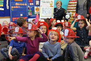 Brian Baker/Town Crier FIREFIGHTERS AT THE READY: Students at Rolph Road School in Leaside are ready to help protect their homes after a thorough briefing by Carol-Lynn Chambers, of the Fire Marshal's office, on Oct. 8. The exercise was part of Fire Safety Week.