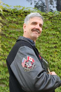 Brian Baker/Town Crier ANSWERING ANOTHER CALL: John Kenny's self-published first novel, The Spark, while not autobiographical, draws on experiences from almost 25 years as a real life firefighter to propel the narrative. He is looking to build on the characters in the book and turn the story into a trilogy.