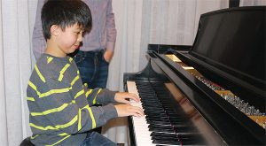BRIAN BAKER/TOWN CRIER TICKLED GOLD: Nicholas Yeh, 10, was awarded a national gold medal Jan. 12 for completing his Grade 5 piano test for the Royal Conservatory.