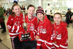 Brian Baker/Town Crier TROPHY HAUL: Emily Moss, Lauren Cutler, Rawley Loftus and Abby Scott of Leaside's Peewee A team, hold up their prize after winning their age group at the 35th Annual March Break Madness Tournament, March 7-9.