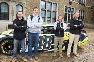 BRIAN BAKER/TOWN CRIER PIT CREW: Northern students, from left, Simon Gillies, Max Samuels, Geoffrey Seeman and Stephen Stothers-Robertson enjoy Alex Tagliani's car outside the school's front doors.