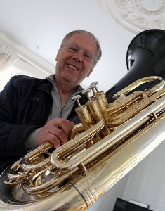 BRIAN BAKER/TOWN CRIER CHUCK DAELLENBACH, a founding member of the Canadian Brass, has many tales to tell — including his role in the famous Pierre Trudeau pirouette behind the Queen's back — after four decades on the road with the country's foremost brass quintet. Seen here with his tuba at his Rosedale home, Daellenbach performed with his troupe at the Mooredale Concert Series on April 27.