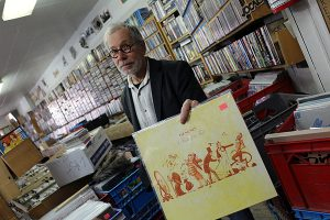 BRIAN BAKER/TOWN CRIER FOR THE RECORD: Bert Myers, proprietor of Vortex Records on Yonge Street, just north of Eglinton Avenue, says running a record store is fun, and he has no worries about the digital world snuffing out his existence.