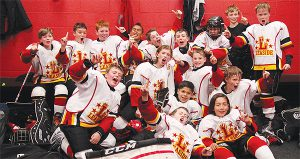 PHOTO COURTESY DAVID THOMSON ALL SMILES: Leaside Flames Atom Red Select team won the North York Hockey League's Tier 1 title over George Bell Titans in three games. Their final game, a 5-1 drubbing of the Titans added an exclamation point to an undefeated season, says coach Matt Angus. The Flames went 22-0-4 on the season.
