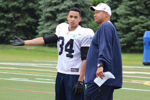 BRIAN BAKER/TOWN CRIER PUT ME IN, COACH: Northern Secondary School alum Eric Black chats with Toronto Argonauts coach Scott Milanovich during rookie camp in May. He was named to the Argos roster, joining older brother of Matt Black, on June 20.