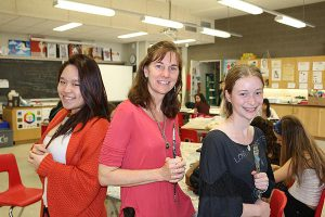 BRIAN BAKER/TOWN CRIER BRUSH WITH REALISM: Lise Marquis, middle, is flanked by her senior visual arts students, Gisele Chen, left, and Samara Goldberg at North Toronto CI.
