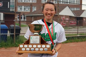 BRIAN BAKER/TOWN CRIER GREEN AND GOLD: Leaside Lancers' captain of the softball team, Madeline Murray, poses with the hardware earned by the team on their trip to the City Championships in early June.