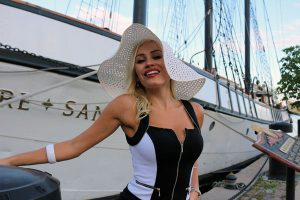 BRIAN BAKER/PUFFINGOD.COM Theresa Longo smiles for the camera during a shoot along Toronto's splendid harbourfront.