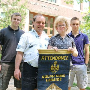 BRIAN BAKER/TOWN CRIER FAMILY FOCUS: The Grantham family, from left, Karl, Ron, Petra and Kurt, is coming together to help celebrate the 75th anniversary of Rolph Road Elementary School.