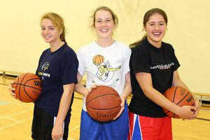 BRIAN BAKER/TOWN CRIER SENIORS AND JUNIOR: Coach David Mizener will be looking for both Grade 11s, like Zoe Astritis, left, and Grade 12s, Chelsea Wallace and Claire Chadwick to work together in the clutch as St. Clement's School's senior girls basketball team heads into a new season.
