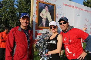 BRIAN BAKER/TOWN CRIER THE DREAM TEAM: Run organizer Chris Henry, left, comedian Nicole Arbour and paralympian Andrew Haley lent a helping hand during the Terry Fox Run at Upper Canada College on Sept. 14.