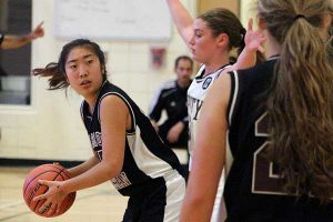 BRIAN BAKER/TOWN CRIER LOOKING FOR AN OPENING: Bishop Strachan's Emily Cho tries find an open teammate during the Bobcats Sept. 25 match against Trinity College. Cho is one of four Grade 12s on a young roster.
