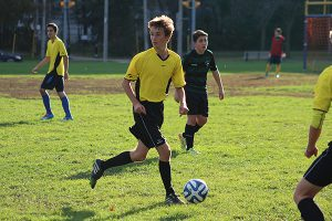 BRIAN BAKER/TOWN CRIER RUNNING FOR THE TEAM: Forest Hill midfielder Jacob Maurutto-Robinson is looking to play in England some day. In the meantime, he's helping his Forest Hill Falcons in their pursuit of a playoff spot.
