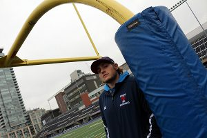 BRIAN BAKER/TOWN CRIER ONE FOR THE RECORD BOOKS: Quarterback Simon Nassar broke a CIS football record on Oct. 4 in the University of Toronto's game against Carleton University. He completed 49 passes on 62 attempts, shattering the record of 41 completions set by another U of T pivot, Dan Feraday, on Oct. 17, 1981.