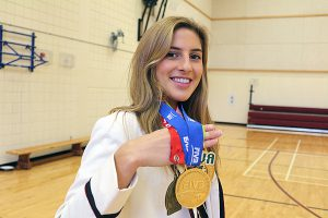 BRIAN BAKER/TOWN CRIER GOLDEN OPPORTUNITIES: Bishop Strachan School senior Tia Miric shows off her medal haul from three years of competition in beach volleyball.