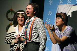 BRIAN BAKER/TOWN CRIER STARS IN THEIR EYES: Emma Spitz, left, Jason Moore and Bil Cho perform as the lead family — Tracy, Wilbur and Edna Turnblad — in Northern Secondary School's adaptation of Hairspray.