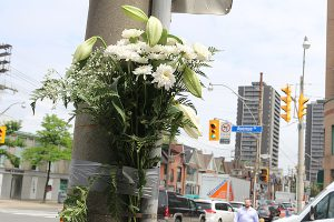 BRIAN BAKER/TOWN CRIER SOBER REMINDER: A bouquet of flowers is left at the Avenue Road an Davenport Road intersection as a makeshift memorial to a 26-year-old cyclist killed in a hit-and-run Saturday night. A 19-year-old Keswick man faces charges.
