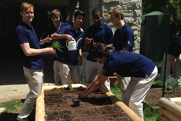 PHOTO COURTESY EMMA TOTTEN DIGGIN' IT: Students from Royal St. George's College's Environment Club work in one of the three gardens built by them for the club.
