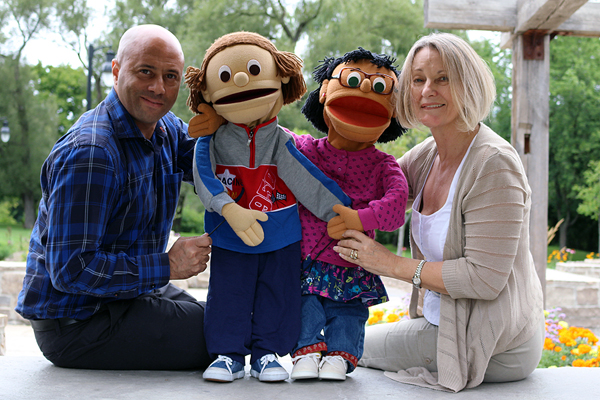 BRIAN BAKER/TOWN CRIER INNER CHILD: Douglas Hurst, left, shows off the puppets Eddie Franklin and Claire Sanchez used in The Concerned Kids programs, with the charity's executive director, Tinda Holland. The organization is hosting a fundraiser at the Miller Tavern, Sept. 17.