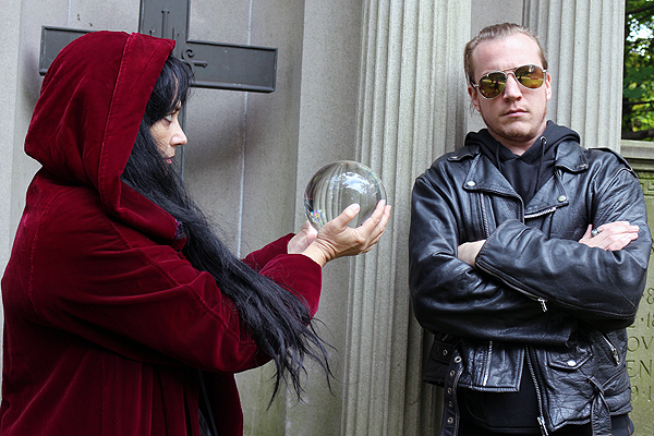 BRIAN BAKER/TOWN CRIER HAVING NONE OF IT: Toronto horror writer Sephera Giron playfully lets Town Crier editor Shawn Star gaze into her crystal ball at Mount Pleasant Cemetery. He's clearly not interested, and feels the same way columnist Brian Baker does about DIY ghostbusters alleging the cemetery is haunted.