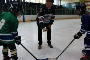 Brian Baker/Town Crier THE OPENING FACEOFF: Toronto mayor John Tory drops the puck for Bradley Hotson, left, and Isabella Rispoli.
