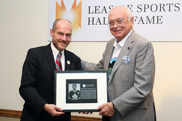 BRIAN BAKER/TOWN CRIER  HAIL TO THE CHIEF: Toronto Maple Leafs legend, George Armstrong, gets his Leaside Sports Hall of Fame plaque from committee member Allan Williams during the Nov. 20 induction ceremony.