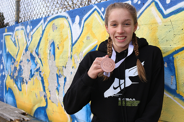 BRIAN BAKER/TOWN CRIER DOUBLE THREAT: Lawrence Park CI's Sydney Winokur won bronze in midget girls' 3080-metre cross country, and looks to return to OFSAA this winter as part of the Panthers' swim team.