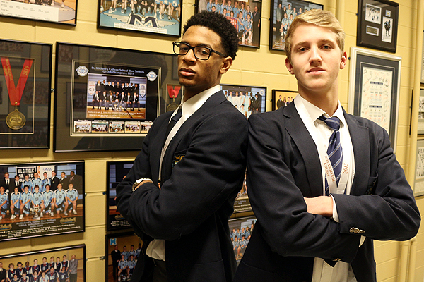 BRIAN BAKER/TOWN CRIER KEEPING THE TRADITION ALIVE: Taryq Sani, left, and Tomas Sorra were a part of St. Mike's OFSAA bronze winning team at the AAA volleyball tournament in November. It's the third time in five years the Strikers have earned hardware at the provincials.