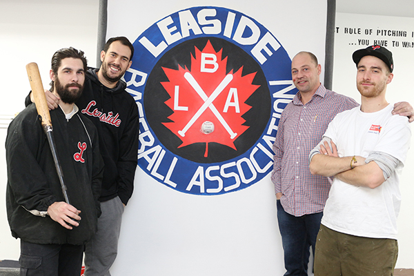 BRIAN BAKER/TOWN CRIER READY TO SWING AWAY: Dave Fischer, left, Eric Stickney, Shawn Murphy and Andrea Maragone stand admiring their work at the Leaside Baseball Association's batting cage, gym and training facility.