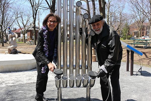 BRIAN BAKER/TOWN CRIER A LITTLE UP-TEMPO FOR THE TEMBO: Sharon Hampson, left, and Bram Morrison play on one of the instruments they chose for the Music Garden at June Rowlands Park. The garden will be opened May 14.