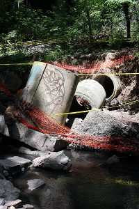 BRIAN BAKER/TOWN CRIER BROKEN: A storm pipe has fallen apart in the Yellow Creek basin due to the erosive effects of storm surges.