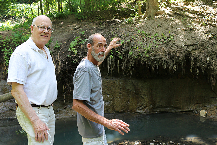 BRIAN BAKER/TOWN CRIER SLIP SLIDIN' AWAY: Summerhill Residents' Association rep John Bossons, left, and Moore Park Residents' Association member Rob Spindler point out the erosive acts that have wasted away hiking trails and created a threat to Toronto's ravines.