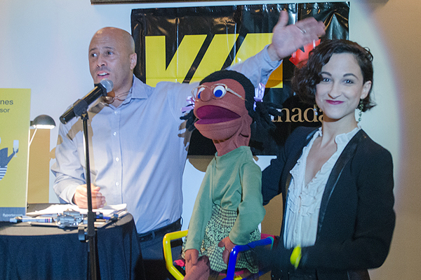 "PHOTO COURTESY THE CONCERNED KIDS HIGHEST BIDDER: Douglas Hurst, left, and Courtney Lamanna take to the microphone during their second annual ""Chair""-ish the Kids Mix and Mingle Fundraiser."